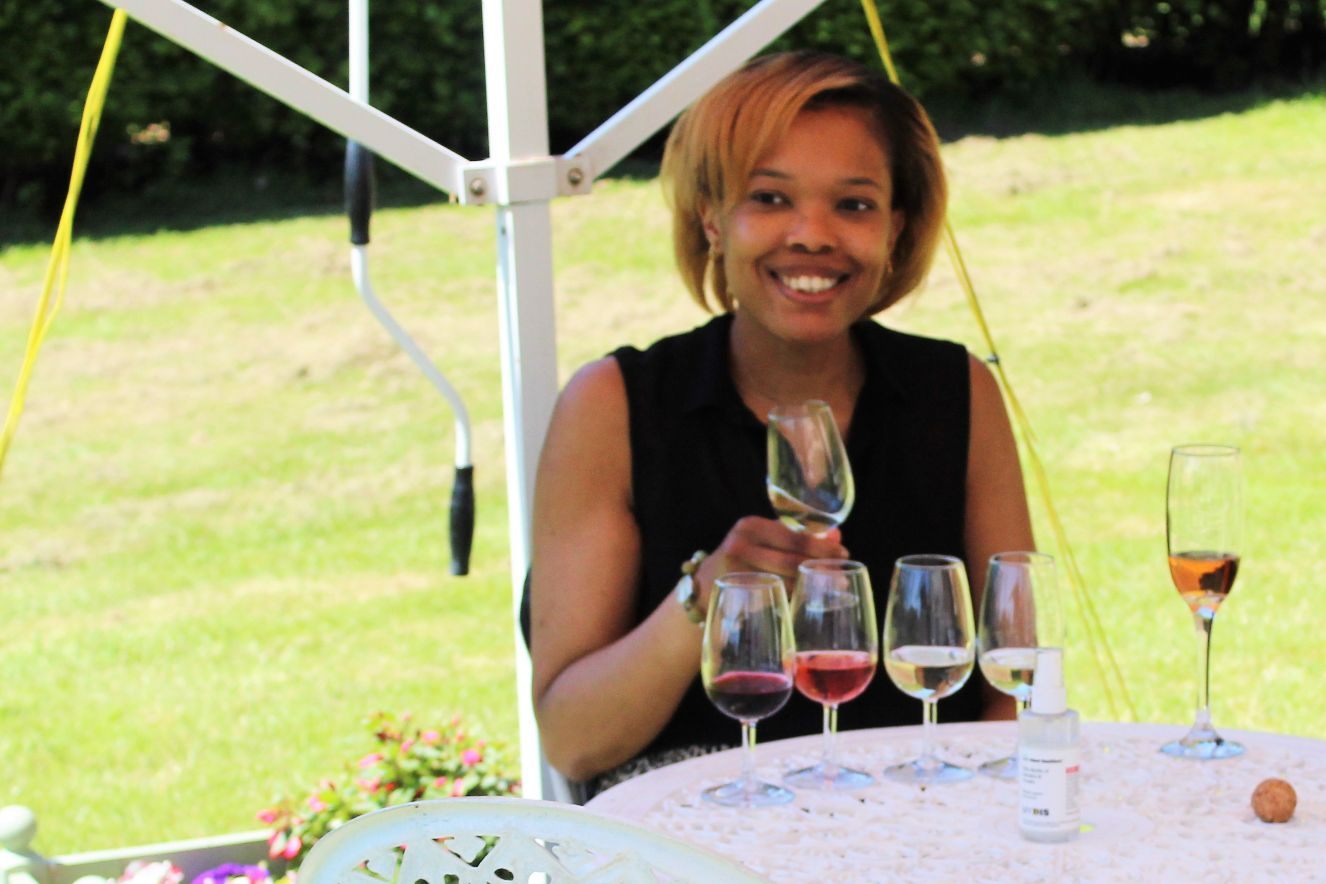 A lady enjoys a wine tasting at Rothley Wine Estate in leicestershire